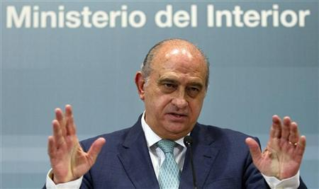 Spain's Interior Minister Jorge Fernandez Diaz gestures as he answers a question during a news conference at the ministry headquarters in Madrid August 2, 2012. REUTERS/Susana Vera