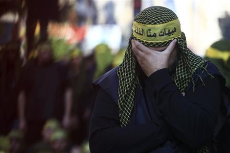 A Lebanese Hezbollah supporter mourns during a ceremony to mark Ashura in Beirut's suburbs, November 25, 2012. Hezbollah leader Sayyed Hassan Nasrallah warned Israel on Sunday that thousands of rockets would rain down on Tel Aviv and other Israeli cities if Israel attacked Lebanon. In a speech marking the Shi'ite Muslim festival of Ashura, Nasrallah said Hezbollah's response to any attack would dwarf the attacks from Gaza during the eight-day conflict between Israel and the Islamist Hamas rulers of the coastal strip. REUTERS/Khalil Hassan