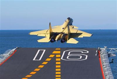 China lands fighter jet on new carrier in show of...