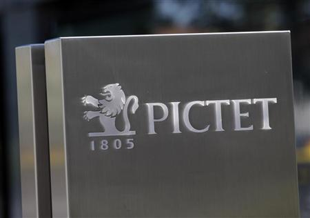A sign bearing the logo of family owned private bank Pictet is pictured at the company headquarters in Geneva May 7, 2012. REUTERS/Denis Balibouse