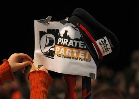 A delegate installs a sign during a party meeting of the Pirate Party (Piraten Partei) in Bochum November 24, 2012. REUTERS/Ina Fassbender