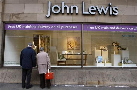 A couple look into the window of a John Lewis store in Edinburgh, Scotland March 11, 2009. REUTERS/David Moir