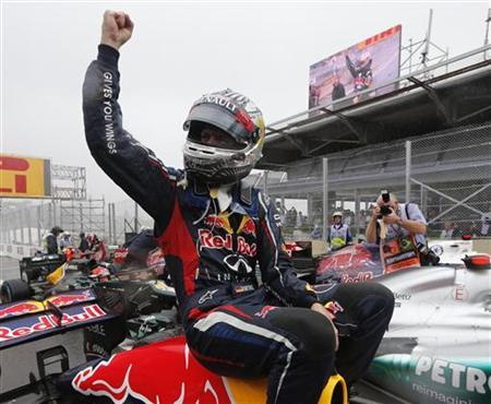 Red Bull Formula One driver Sebastian Vettel of Germany celebrates winning the world championship after finishing sixth in the Brazilian F1 Grand Prix at Interlagos circuit in Sao Paulo November 25, 2012. Vettel became Formula One's youngest triple world champion at the age of 25 at the Brazilian Grand Prix on Sunday. REUTERS/Paulo Whitaker