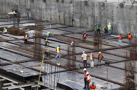 Workers are seen at a construction site in Bonifacio Global City central business district in Taguig City Metro Manila November 15, 2012. The capital of the Philippines is in the throes of a property boom described as the best in two decades, reflecting the increasing confidence in an economy that only recently began shedding its image as one of the region's basket cases. Picture taken November 15, 2012. To go with PHILIPPINES-PROPERTY/ REUTERS/Cheryl Ravelo