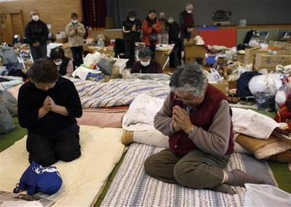 Victims of the March 11 earthquake and tsunami observe a minute of silence at a shelter in Kamaishi, Iwate prefecture, in this April 11, 2011 file photograph, marking the one month anniversary of the deadly quake which triggered the tsunami and nuclear crisis in Japan. Weeks before Japan's first national election on December 16, 2012, since the earthquake, none of the contenders has managed to win the hearts, and votes, of those hardest-hit by the disaster - with many feeling let down by the entire political class. Volunteers and donations had poured in after the magnitude 9.0 quake off the northeast coast of Japan's main island Honshu unleashed a deadly tsunami that killed nearly 19,000 and triggered reactor meltdowns at the Fukushima nuclear plant. But 20 months later, residents of towns and cities ravaged by the country's worst disaster in generations say the nation's biggest rebuilding effort since the aftermath of the World War Two has slipped off the political agenda. REUTERS/Toru Hanai/Files