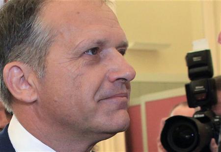 Former Austrian Interior Minister Ernst Strasser waits for a session of an inquiry hearing (Untersuchungsausschuss) to begin in the parliament in Vienna June 20, 2012. REUTERS/Herwig Prammer