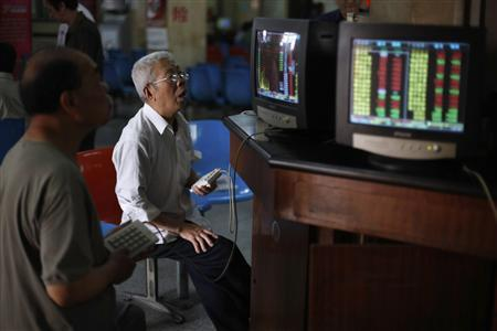 Investors look at computer screens showing stock information at a brokerage house in Shanghai in this June 8, 2012 file photo. Foreign investors have started rebuilding their China equity portfolios, tempted by low valuations after two years of market underperformance and signs economic growth may be stabilizing. They have pumped nearly $4 billion (2 billion pounds) into Chinese equity funds in the past two months alone, trying to get in early on what they hope will be a sustained rally. Picture taken June 8, 2012. REUTERS/Aly Song/Files
