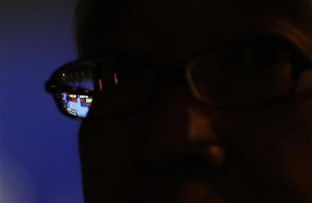 A stock index board is seen through a pair of glasses of a pedestrian outside a brokerage in Tokyo November 22, 2012. REUTERS/Kim Kyung-Hoon