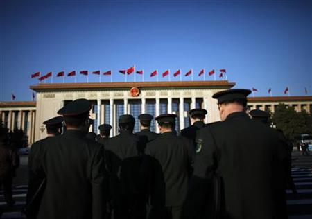 Military delegates walk towards the Great Hall of the People before the closing session of the 18th National Congress of the Communist Party of China in Beijing, November 14, 2012. REUTERS/Carlos Barria