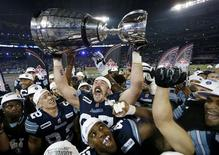 Toronto Argonauts Jeff Keeping celebrates with the Grey Cup after the Argonauts defeated the Calgary Stampders in the 100th CFL Grey Cup championship football game in Toronto, November 25, 2012. REUTERS/Mark Blinch