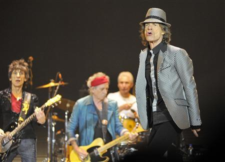 Mick Jagger performs with the Rolling Stones at the O2 Arena in London November 25, 2012. The Stones took to the stage on Sunday after a five-year hiatus to celebrate the golden jubilee of one of the most successful and enduring bands in rock and roll history. Now in their mid-60s to early 70s, lead singer Jagger, guitarists Keith Richards and Ronnie Wood and drummer Charlie Watts were joined by former members Bill Wyman and Mick Taylor for concerts in London and the United States. REUTERS/Toby Melville