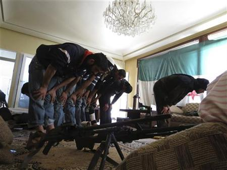 Free Syrian Army fighters perform their prayers on the outskirts of Aleppo November 20, 2012. Picture taken November 20, 2012. REUTERS/Maher al-Hur/Shaam News Network/Handout