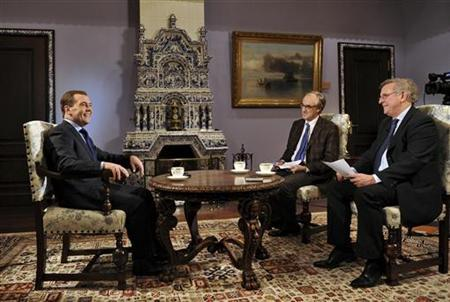 Russian Prime Minister Dmitry Medvedev (L) gives an interview to journalists representing French media ahead of his visit to Paris at the Gorki state residence outside Moscow in this undated photo released November 26, 2012. REUTERS/Alexander Astafyev/RIA Novosti/Pool