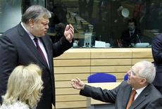 Greece's Finance Minister Evangelos Venizelos (L) talks with Germany's Finance Minister Wolfgang Schaeuble at the start of a Eurogroup meeting ahead of a two-day EU leaders summit in Brussels March 1, 2012. REUTERS/Francois Lenoir