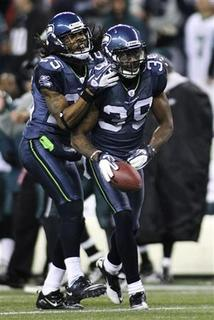 Seattle Seahawks cornerback Brandon Browner (39) is congratulated by teammate Richard Sherman (L) after Browner intercepted a pass intended for Philadelphia Eagles wide receiver Riley Cooper (not pictured) during the fourth quarter of their NFL football game at Centurylink Field in Seattle, December 1, 2011. REUTERS/Anthony Bolante