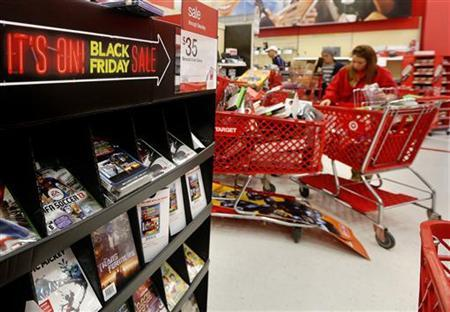 A 'Black Friday' sale sign is seen inside a Target store in Westbury, New York November 23, 2012. Black Friday, the day following the Thanksgiving Day holiday, has traditionally been the busiest shopping day in the United States. REUTERS/Shannon Stapleton (UNITED STATES - Tags: BUSINESS SOCIETY)