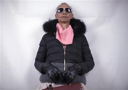 72-year-old Liu Qianping, also known as ''MaDiGaGa'', poses during a modelling shoot in the southern Chinese city of Guangzhou November 24, 2012. Liu was visiting his 24-year-old granddaughter, Lu Ting in the southern Chinese city of Guangzhou one day when the women's clothes Lu was packing into boxes caught his eye. His visit came as the model that his granddaughter and four friends had booked for a photo shoot to promote their online fashion business suddenly cancelled, so, Liu, a 72-year-old former farmer visiting to escape the chilly winter of central Hunan province, stepped in to help. Picture taken November 24, 2012. REUTERS/Tyrone Siu