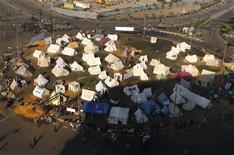 Protesters and activists stay in tents as they continue their sit-in, after Egyptian President Mohamed Mursi issued a decree temporarily widening his powers and shielding his decisions from judicial review, at Tahrir Square in Cairo, November 26, 2012. REUTERS/Asmaa Waguih