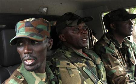 Congolese Revolution Army (CRA) rebel leader Sultani Makenga (L) sits in a truck in Goma in the eastern Democratic Republic of Congo (DRC), November 20, 2012, soon after the rebels captured the city from the government army. REUTERS/James Akena