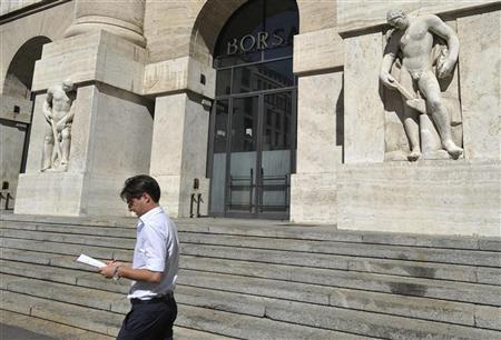 A man walks past the stock exchange in downtown Milan September 13, 2012. REUTERS/Paolo Bona