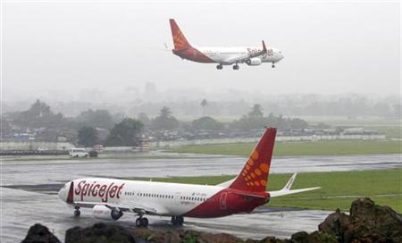SpiceJet aircrafts prepare for landing and take-off at the airport in Mumbai July 15, 2008. REUTERS/Punit Paranjpe/Files