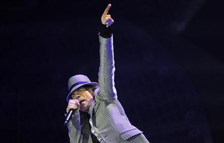 Mick Jagger performs with the Rolling Stones at the O2 Arena in London November 25, 2012. REUTERS/Toby Melville