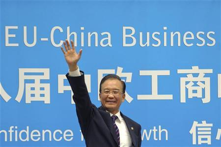 China's Premier Wen Jiabao waves during the European Union-China summit at the Egmont Palace in Brussels September 20, 2012. REUTERS/Laurent Dubrule