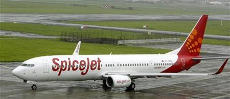 SpiceJet aircraft prepares for takeoff at the airport in Mumbai July 15, 2008. REUTERS/Punit Paranjpe/Files