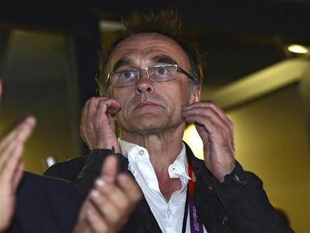 Danny Boyle, the director of the London 2012 Olympic Games opening ceremony reacts during the ceremony at the Olympic Stadium July 27, 2012. REUTERS/Toby Melville