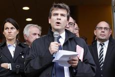 France's Minister for Industrial Recovery Arnaud Montebourg (C) addresses employees of ArcelorMittal after a meeting with trade union representatives at the town hall in Florange, Eastern France, September 27, 2012. REUTERS/Vincent Kessler