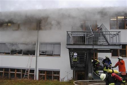Firemen attend the scene of a fire at a workshop for disabled people in Titisee-Neustadt in the Black Forest region in south west Germany November 26, 2012. REUTERS/Kamara 24.TV