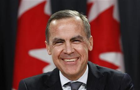 Bank of Canada Governor Mark Carney laughs during a news conference in Ottawa November 26, 2012. Carney will take over the reins as Governor of the Bank of England next year, British finance minister George Osborne told parliament on Monday, announcing a surprise choice to replace outgoing Bank of England Governor Mervyn King. REUTERS/Chris Wattie (CANADA - Tags: BUSINESS POLITICS)