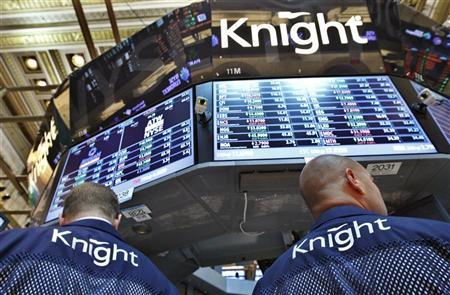 Knight Capital traders work at the company's kiosk on the floor of the New York Stock Exchange, August 6, 2012. REUTERS/Brendan McDermid