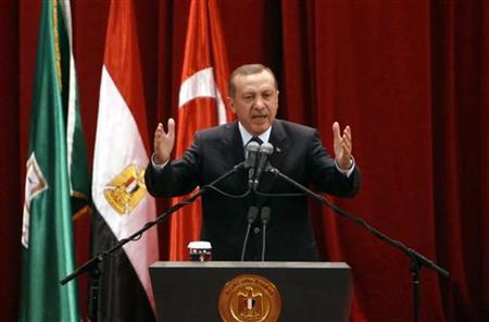 Turkish Prime Minister Tayyip Erdogan delivers a speech at Cairo University after his meeting with Egyptian President Mohamed Mursi, during the first day of his two-days' trip to Egypt, November 17, 2012. Erdogan, an outspoken of critic of Israel, praised Mursi, on Saturday for recalling his ambassador from Tel Aviv in response to Israeli attacks on Gaza. REUTERS/Asmaa Waguih