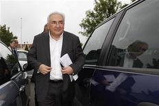 Former IMF head Dominique Strauss-Kahn arrives at a polling station in the second round of the 2012 French presidential elections in Sarcelles May 6, 2012. Voting started in mainland France on Sunday in the runoff presidential elections. REUTERS/Gonzalo Fuentes