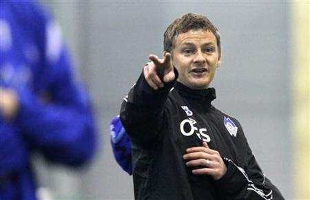 Former Manchester United striker Ole Gunnar Solskjaer calls out instructions at his first session as manager for Norwegian team Molde in Molde January 12, 2011. REUTERS/Cornelius Poppe/Scanpix/Files