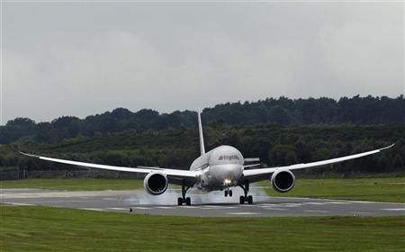 A Boeing 787 Dreamliner lands after performing a display flight at the Farnborough Airshow 2012 in southern England July 9, 2012. REUTERS/Luke MacGregor