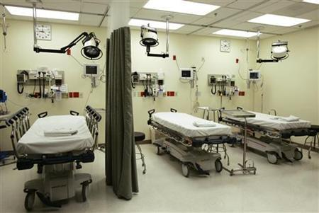 Beds lie empty in the emergency room of Tulane University Hospital in New Orleans February 14, 2006. REUTERS/Lee Celano