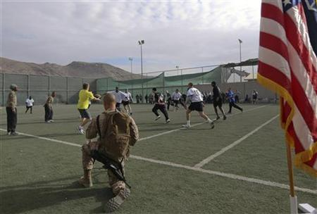 U.S. troops play touch football in the early morning hours on Thanksgiving at a military base in Kabul, November 22, 2012. REUTERS/Omar Sobhani
