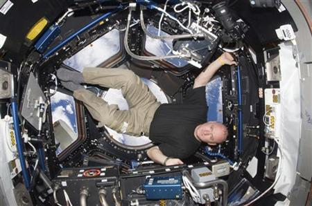 NASA astronaut Scott Kelly, Expedition 25 flight engineer, is pictured in the Cupola of the International Space Station in this October 14, 2010 photograph released on November 26, 2012. REUTERS/NASA/Handout