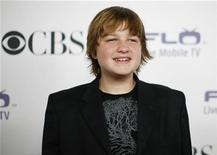 Actor Angus T. Jones poses at the CBS comedies' season premiere party in Los Angeles September 17, 2008. REUTERS/Mario Anzuoni