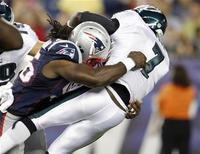 New England Patriots linebacker Jermaine Cunningham (L) sacks Philadelphia Eagles quarterback Michael Vick during the first quarter of their preseason NFL football game in Foxborough, Massachusetts August 20, 2012. REUTERS/Jessica Rinaldi