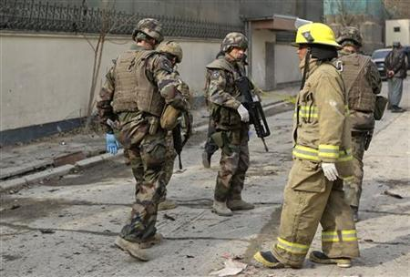 NATO troops arrive at the site of a suicide bomb attack in Kabul November 21, 2012. REUTERS/Omar Sobhani