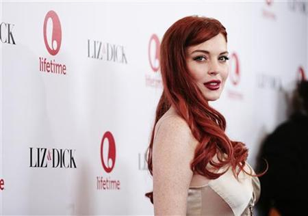 Actress Lindsay Lohan arrives for a private dinner celebrating the upcoming premiere of ''Liz & Dick'' at the Beverly Hills Hotel in Beverly Hills, California November 20, 2012. ''Liz & Dick'' is a television film starring Lohan as actress Elizabeth Taylor. REUTERS/Jason Redmond