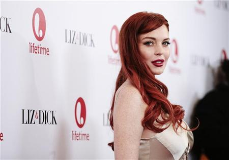 Actress Lindsay Lohan arrives for a private dinner celebrating the upcoming premiere of ''Liz & Dick'' at the Beverly Hills Hotel in Beverly Hills, California November 20, 2012. REUTERS/Jason Redmond