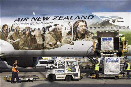 An Air New Zealand Boeing 777-300ER featuring livery advertising the film The Hobbit: An Unexpected Journey is loaded by ground crew after landing at Heathrow Airport, en route to Los Angeles and then Auckland, in London. November 25, 2012. The aircraft is picking up actors and crew along the route to attend the film's premiere in New Zealand. REUTERS/Neil Hall