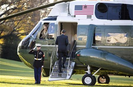 U.S. President Barack Obama boards Marine One before departing for a trip to Thailand, Burma and Cambodia from the White House in Washington November 17, 2012. REUTERS/Joshua Roberts