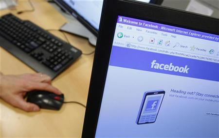 A Facebook page is displayed on a computer screen in Brussels April 21, 2010. REUTERS/Thierry Roge