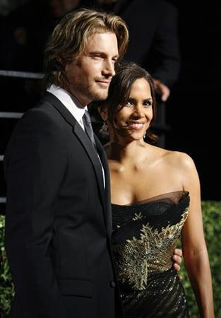 File photo of actress Halle Berry and model Gabriel Aubry posing as they arrive at the 2009 Vanity Fair Oscar Party in West Hollywood, California February 22, 2009. REUTERS/Danny Moloshok