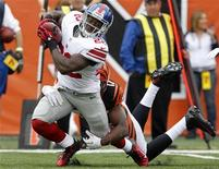 New York Giants' David Wilson (22) is tackled by Cincinnati Bengals' Mohamed Sanu (12) during the first half of play in their NFL football game at Paul Brown Stadium in Cincinnati, Ohio, November 11, 2012. REUTERS/John Sommers II